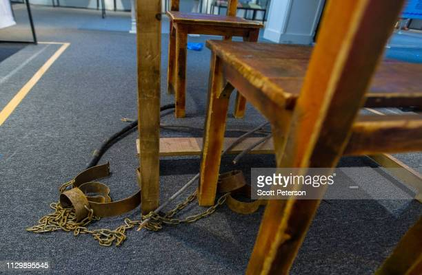 The chains manacles and whips used by one victim of torture to tell his story as Afghans view exhibits showcasing the memories and objects belonging...