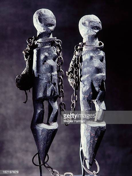 The chains on this double figured Fon bocio are both a symbol of Gu the vodu of iron and war and an image of slavery Fon religion was directed...