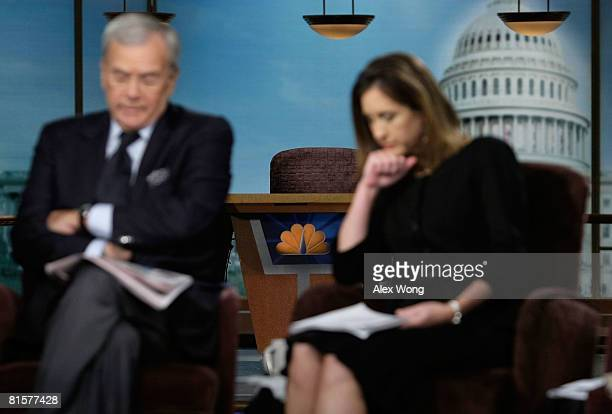 The chair of the late moderator of 'Meet the Press' Tim Russert sits empty on the set as former NBC Nightly News anchor Tom Brokaw and MTP Executive...
