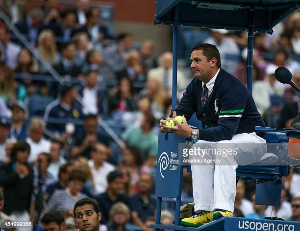 The chair umpire holds tennis balls after Kei Nishikori of Japan request to change tennis balls during the men's singles final match against Marin...