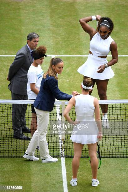 The chair umpire perform a coin toss ahead of the Ladies' Singles final between Serena Williams of The United States and Simona Halep of Romania...