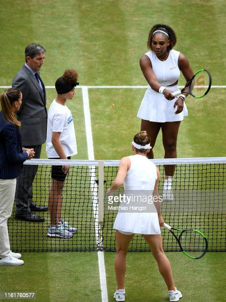 The chair umpire prepare for a coin toss ahead of the Ladies' Singles final between Serena Williams of The United States and Simona Halep of Romania...