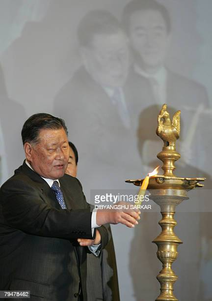 The Chairman and Chief Executive Officer of Hyundai Motor Company MongKoo Chung lights the traditional lamp during the inauguration of a new plant in...