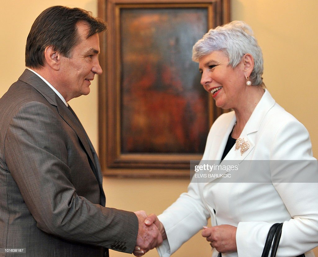 The chairman of Bosnia's tripartite presidency, Haris Silajdzic (L), shakes hands with Croatian Prime Minister Jadranka Kosor on June 5, 2010 before their meeting in Sarajevo. Kosor is on a one-day visit to Bosnia and Herzegovina.