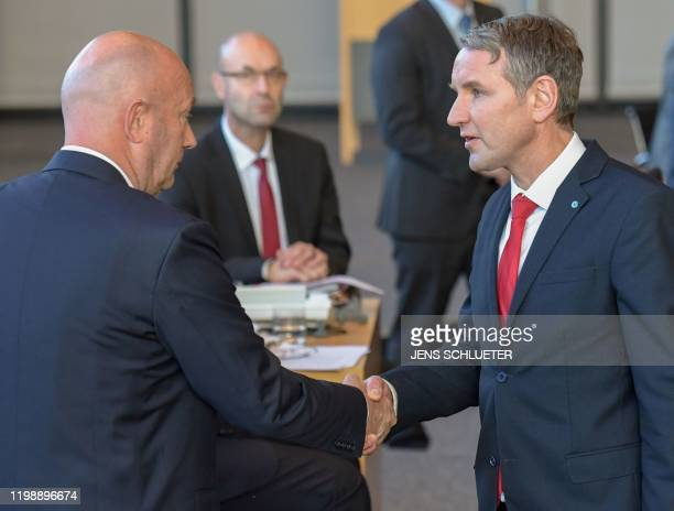 The Chairman of farright AfD party parliamentary group in Thuringia Bjoern Hoecke congratulates Thomas Kemmerich leader of the state branch of...