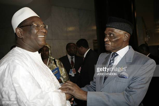 The chairman of the African Union Commission Alpha Omar Konare talks to the Senegalese President Abdoulaye Wade during the 10th African Union Summit...