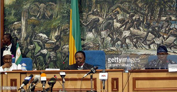 The chairman of the African Union commission Alpha Oumar Konare and Gabonese President Omar Bongo listen to Nigerian President and current chairman...