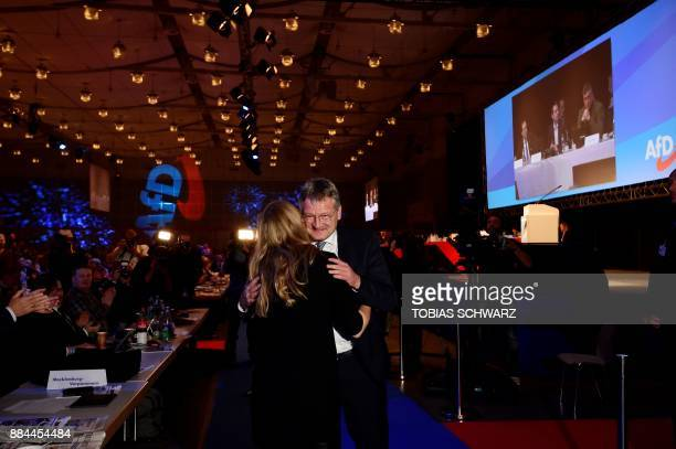 The chairman of the Alternative for Germany farright party Joerg Meuthen is congratulated after he was reelected for two years during the congress of...