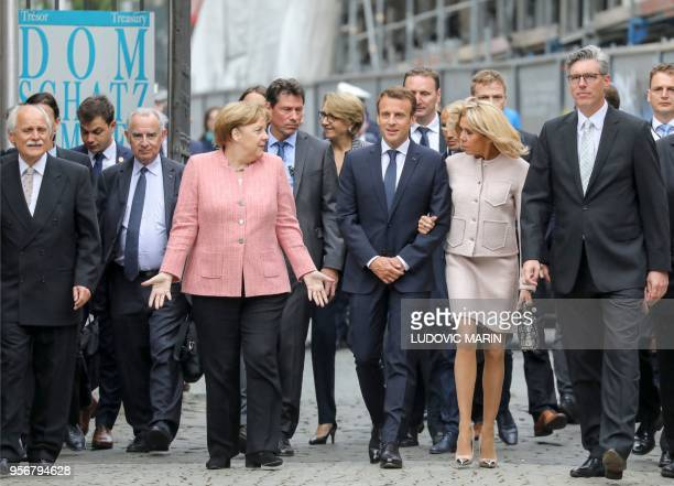 TOPSHOT The chairman of the Charlemagne Prize board Juergen Linden German Chancellor Angela Merkel French President Emmanuel Macron and his wife...