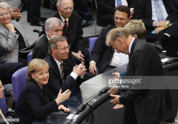 The chairman of the Greensfraction in the Bundestag Juergen Trittin bows low in front of German Chancellor and head of the German Christian Democrats...