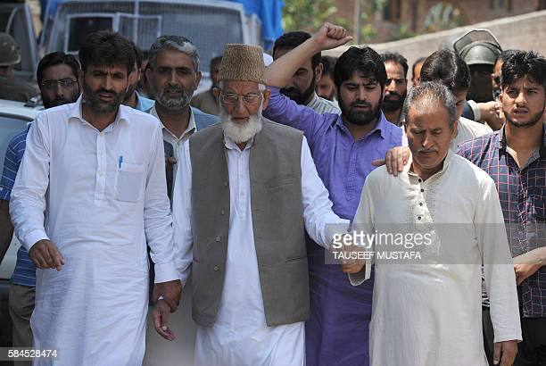 The chairman of the hardliner faction of the All Parties Hurriyat Conference, Syed Ali Geelani walks with supporters before being detained by Indian...
