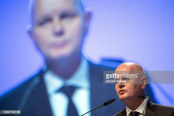 The chairman of the Metro AG Olaf Koch speaks during the main assembly in Duesseldorf Germany 6 February 2017 The shareholders of the trade giant are...