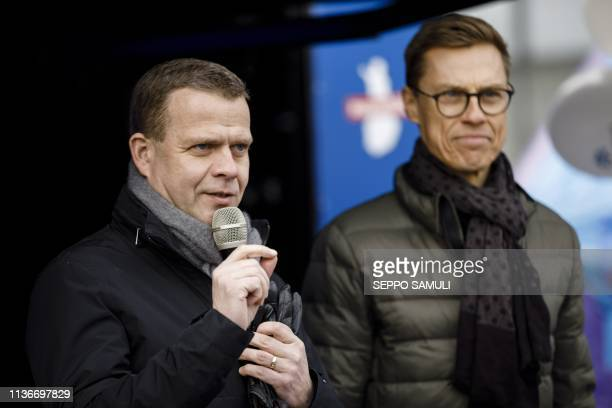 The chairman of the National Coaltion Party and parliamentary candidate Petteri Orpo speaks next to the Vice President of European Investment Bank...