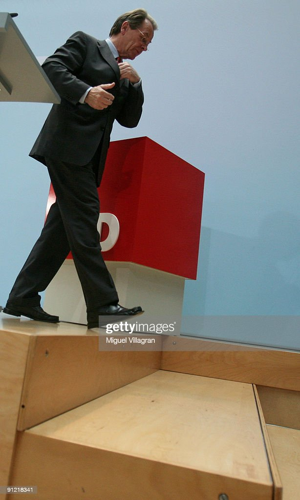 The chairman of the Social Democratic Party (SPD) Franz Muentefering leaves a news conference on September 28, 2009 in Berlin, Germany. With 23.0 percent the SPD was the biggest loser in Germany's election.