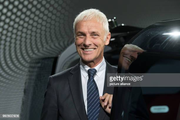 The chairman of the VWAG Matthias Mueller can be seen standing next to the Volskwagen concept vehicle 'Sedric' after his preformance at the...