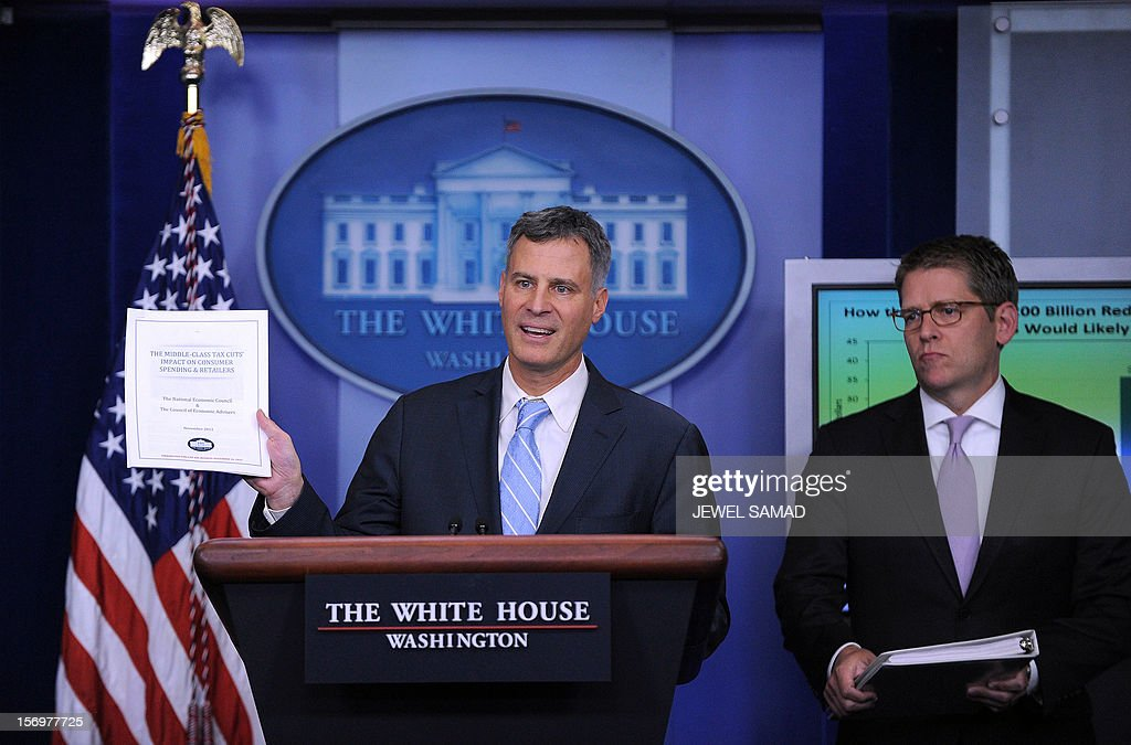 The Chairman of US President Barack Obama's Council of Economic Advisers Alan Krueger speaks as White House Press Secretary Jay Carney looks on during a press briefing at the White House in Washington, DC, on November 26, 2012. The White House warned Monday that American consumers will spend $200 billion less in 2013 if the looming fiscal cliff is not averted and automatic tax hikes are triggered across the board. If no deal is reached before the end of the year, a poison pill of tax hikes and massive spending cuts, including slashes to the military, comes into effect with potentially catastrophic effects for the fragile US economy. AFP PHOTO/Jewel Samad
