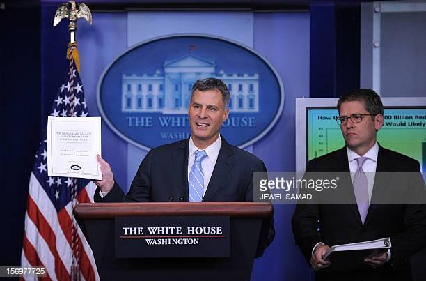 The Chairman of US President Barack Obama's Council of Economic Advisers Alan Krueger speaks as White House Press Secretary Jay Carney looks on...