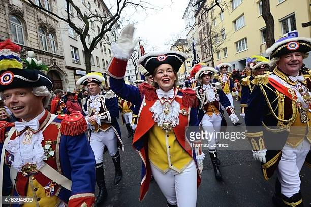 The chairwoman of the CDU in RhinelandPalatinate celebrates with the 'Ranzengarde' at the Monday carnival parade on March 3 2014 in Mainz Germany...