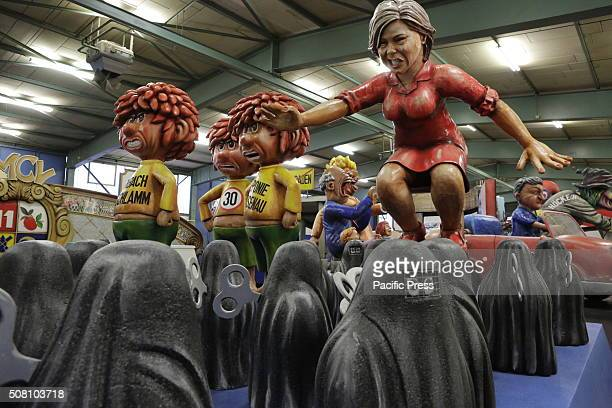 The chairwoman of the CDU in RhinelandPalatinate Julia Kloeckner is depicted as a papiermache figure standing on top of a chair which is surrounded...