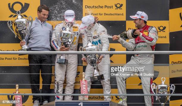 The Champagne party going on with Lucas Auer of MercedesAMG DTM Team Muecke Timo Glock of BMW M4 Team RMG and Mike Rockenfeller of Audi RS5 Sport...
