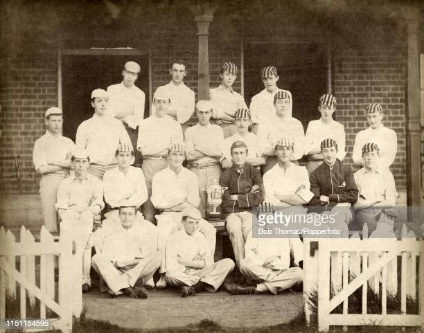 The Champion Cricket Elevens made up of the C Colbeck and AG Watson Houses at Harrow School with their trophy circa June 1890 Left to right back row...