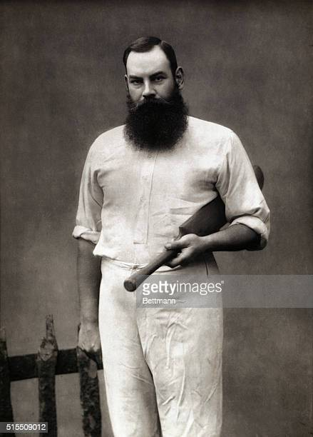 The champion English cricketer, W.G. Grace, posing with his cricket bat and wearing traditional white uniform, in 1887.