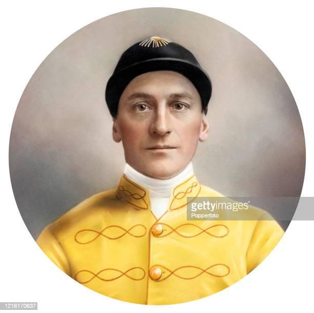 The champion jockey Bernard Carslake wearing yellow and orange embroidered silks and a cap circa 1925
