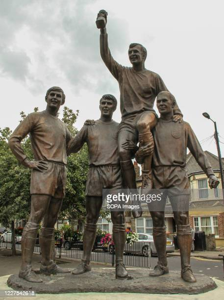 The Champions, a bronze sculpture located on Barking Road and close to West Ham Football Club old stadium Boleyn Ground at Upton Park in East London....