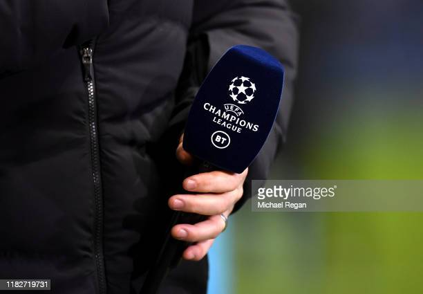 The Champions League and BT Sport logos are seen on a microphone prior to the UEFA Champions League group C match between Manchester City and...
