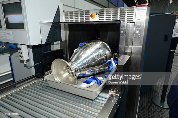 The Champions League trophy goes through airport security on the way to the Chelsea victory parade
