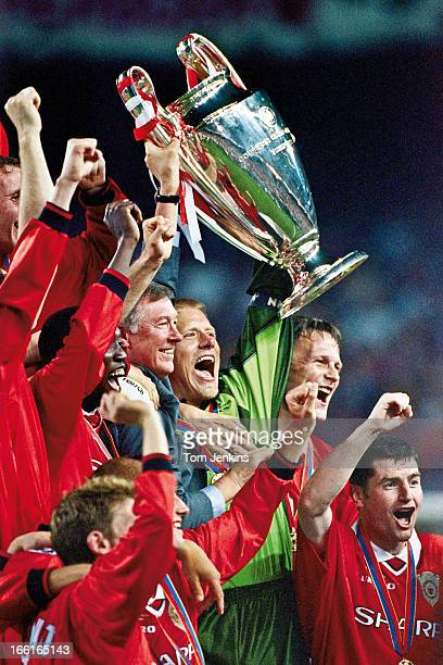 The Champions League trophy is raised aloft by Manchester United manager Sir Alex Ferguson and goalkeeper Peter Schmeichel after their victory over...