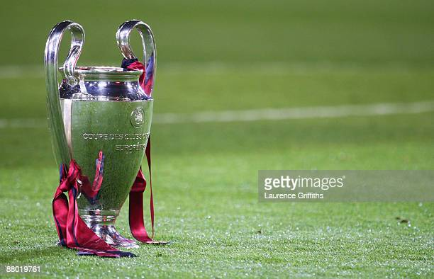 The Champions League trophy sits on the grass after the UEFA Champions League Final match between Manchester United and Barcelona at the Stadio...