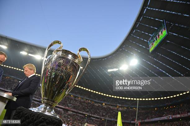 The Champions League trophy stands next to the pitch prior to the UEFA Champions League second-leg semi-final football match FC Bayern Munich vs Real...
