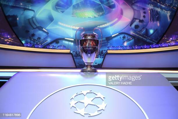 The Champions League Trophy stands on display during the UEFA Champions League football group stage draw ceremony in Monaco on August 29 2019