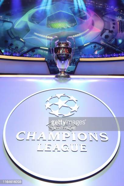 The Champions League Trophy stands on display during the UEFA Champions League football group stage draw ceremony in Monaco on August 29, 2019.