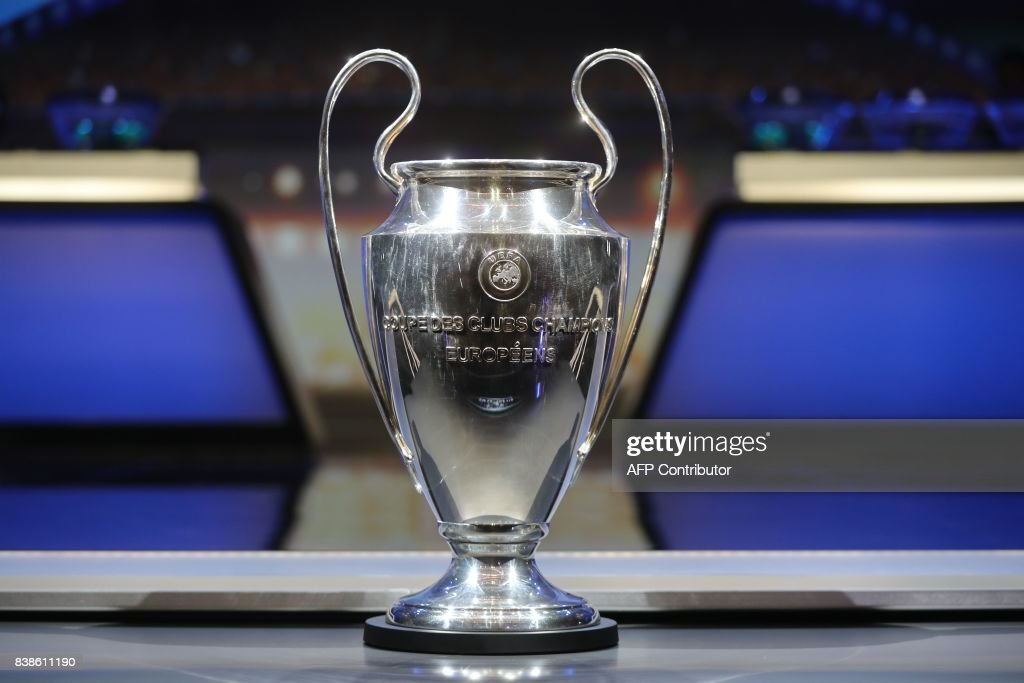 The Champions League Trophy stands on display during the UEFA Champions League football group stage draw ceremony in Monaco on August 24, 2017. /
