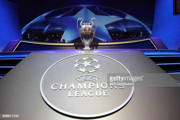 The Champions League Trophy stands on display during the UEFA Champions League football group stage draw ceremony in Monaco on August 24, 2017. / AFP...