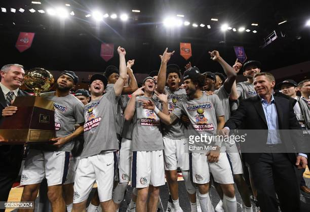 The championship trophy is handed to the Gonzaga Bulldogs players and head coach Mark Few after they defeated the Brigham Young Cougars 7454 to win...