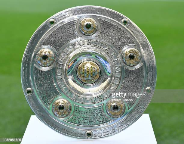 The Championship trophy is seen prior to the the Bundesliga match between VfL Wolfsburg and FC Bayern Muenchen at Volkswagen Arena on June 27, 2020...