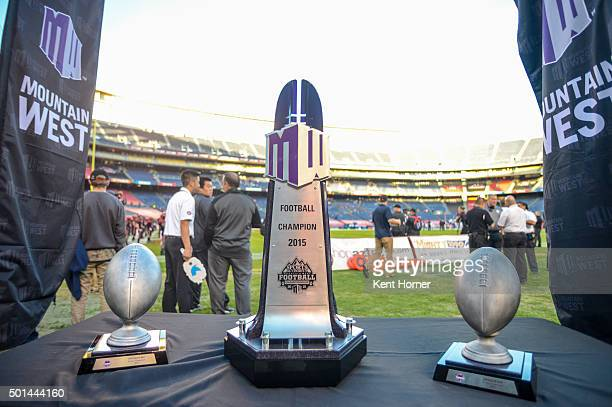 The Championship Trophy with the Offensive and Defensive Player of the Game trophies sit on a table fieldside prior to the Mountain West Championship...
