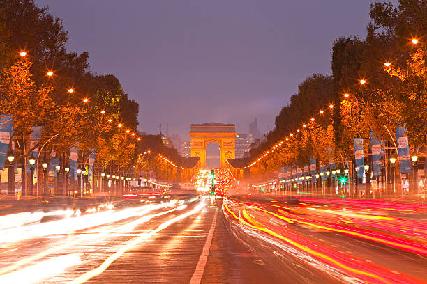 the champs elysees and arc de triomphe at night photos com