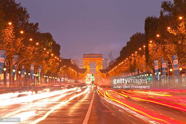 The Champs Elysees and Arc de Triomphe at night.
