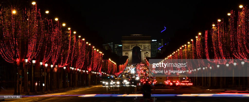 Image result for champs elysees illuminated in red