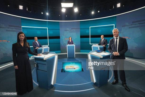 The Chancellor candidates Armin Laschet , Annalena Baerbock and Olaf Scholz attend the TV debate between the three candidates for Chancellor with...