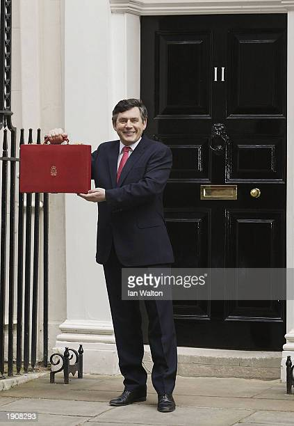 The Chancellor Gordon Brown holds up his briefcase which contains the budget outside Downing Street London on April 9 2003