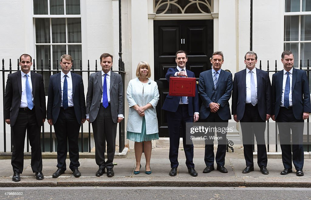 The Chancellor of the Exchequer George Osborne (4th R) and his treasury team Greg Hands, David Gauke, Damian Hinds, Harriet Baldwin and Lord O'Neill of Gatley present the ministerial red box up to the media as he leaves 11 Downing Street on July 8, 2015 in London, England. The Chancellor is presenting his summer budget today to Parliament and is expected to announce £12 billion in welfare cuts.