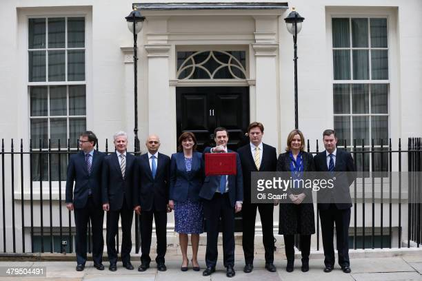 The Chancellor of the Exchequer George Osborne holding the budget box stands with his Treasury team Parliamentary Private Secretary to George Osborne...