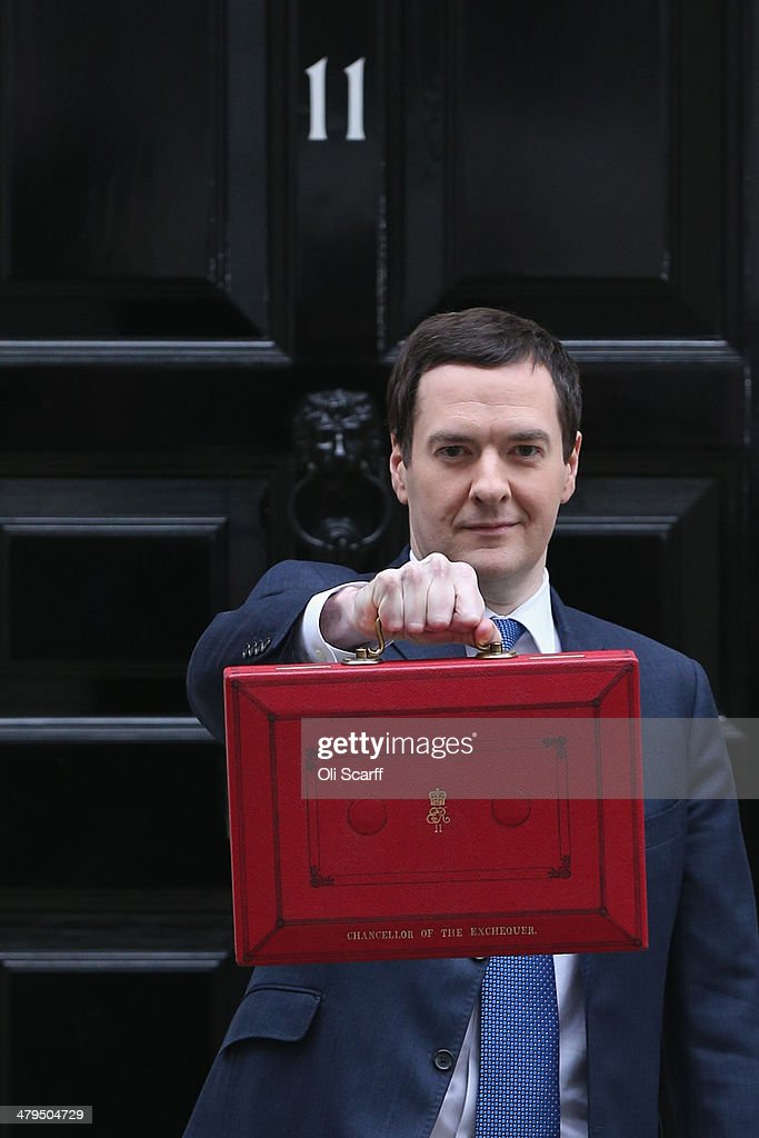 The Chancellor of the Exchequer George Osborne holding the budget box outside Number 11 Downing Street on March 19, 2014 in London, England. The Chancellor of the Exchequer will deliver his Budget statement to Members of Parliament in the House of Commons later.
