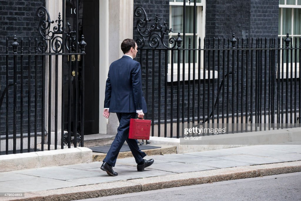 The Chancellor of the Exchequer George Osborne, holding the budget box, leaves Number 11 Downing Street on March 19, 2014 in London, England. The Chancellor of the Exchequer will deliver his Budget statement to Members of Parliament in the House of Commons later.