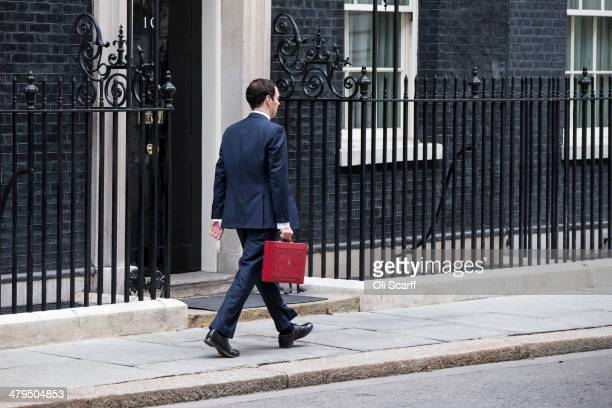 The Chancellor of the Exchequer George Osborne holding the budget box leaves Number 11 Downing Street on March 19 2014 in London England The...